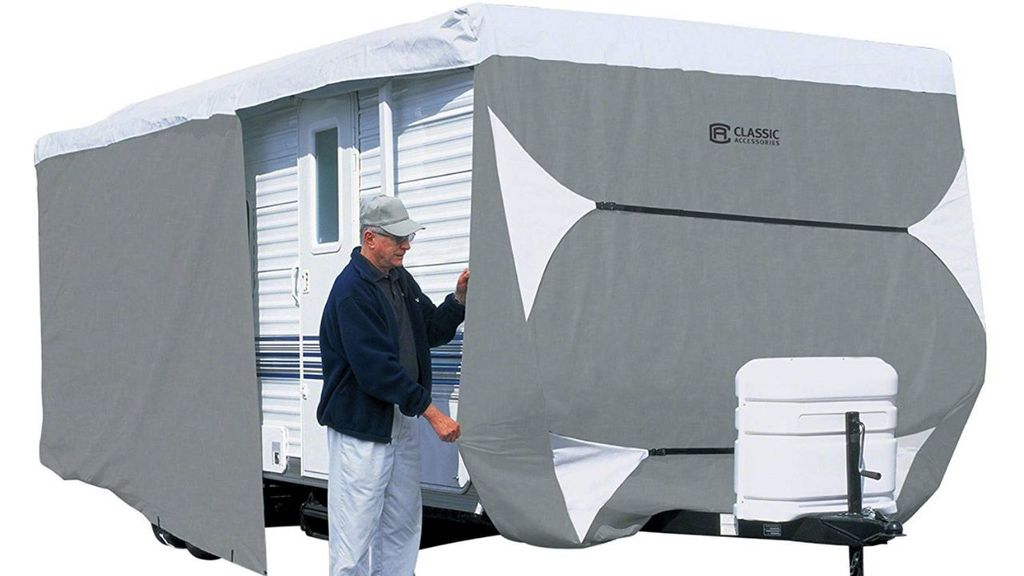 man fixing his rv cover