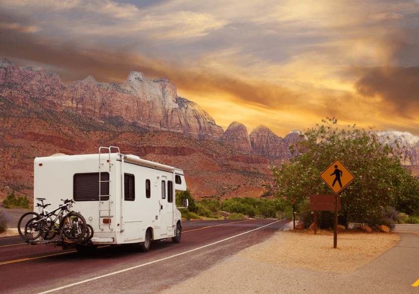 rv in the road during sunset