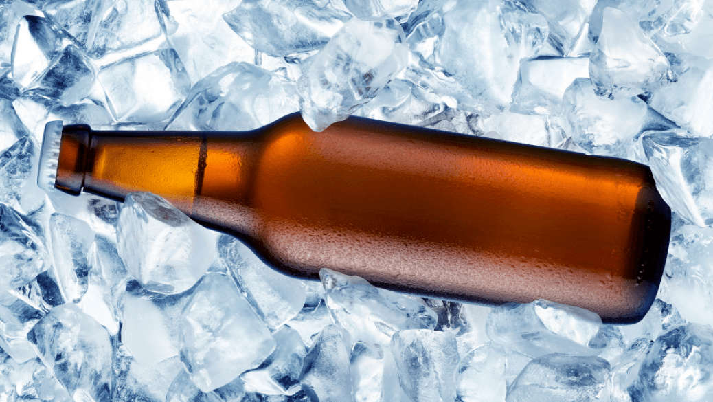 bottle of beer in ice cubes