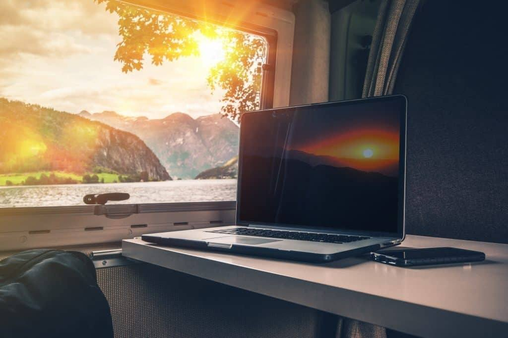 laptop placed on top of table in RV