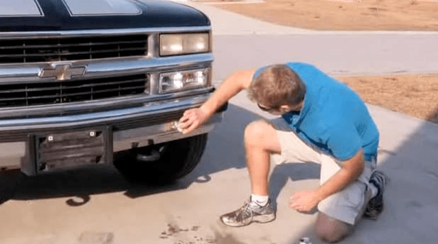 man apply rust remover to his car