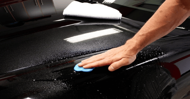 person using rush remover for car