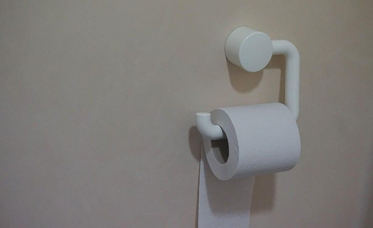 toilet paper placed on handle