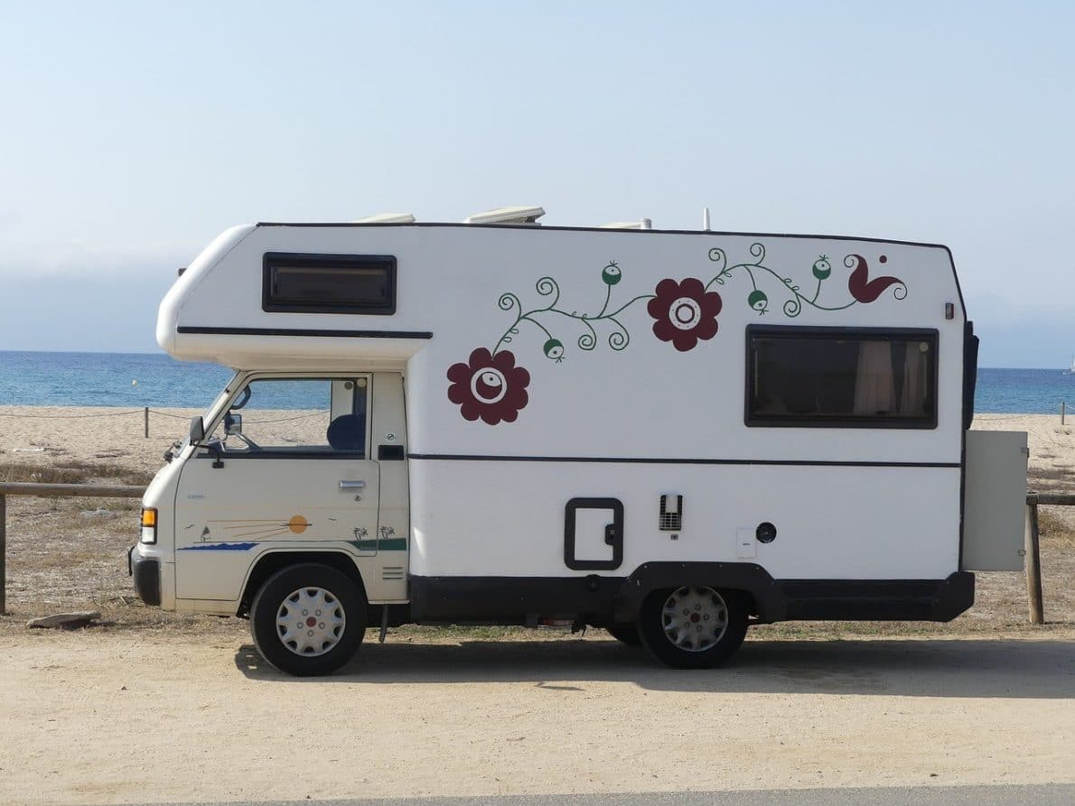 rv vehicle traveling on the beach