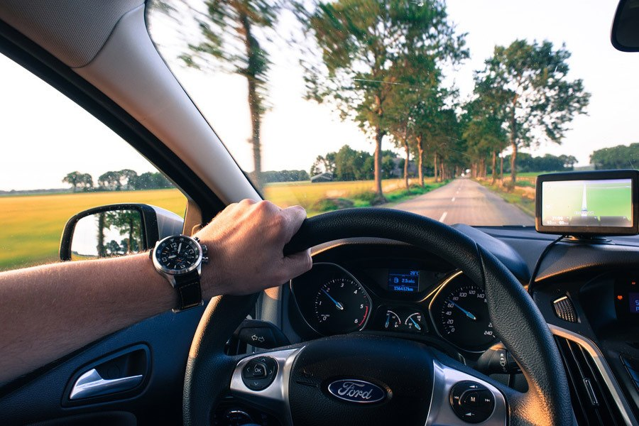 Hand controlling the car Steering Wheel