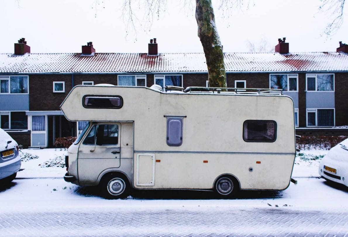 White RV parked on a street