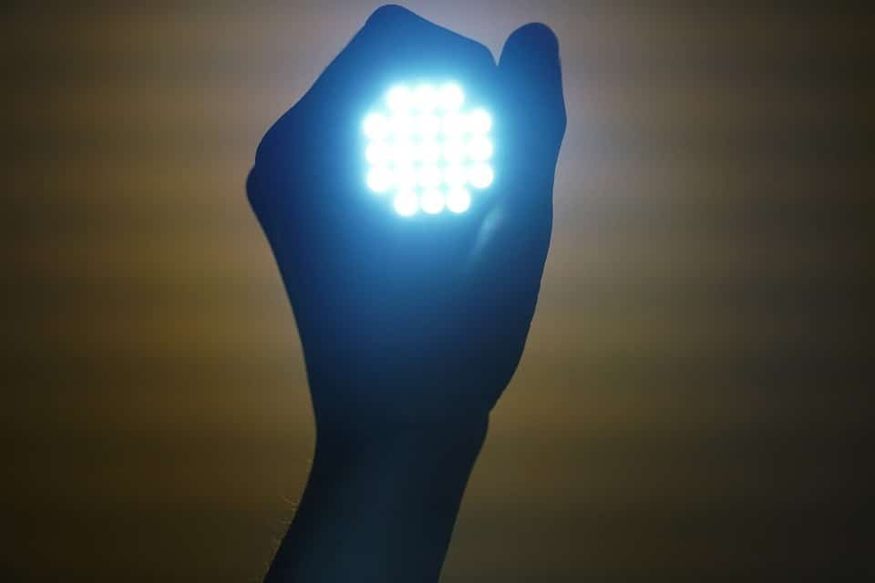 A person is holding a led light