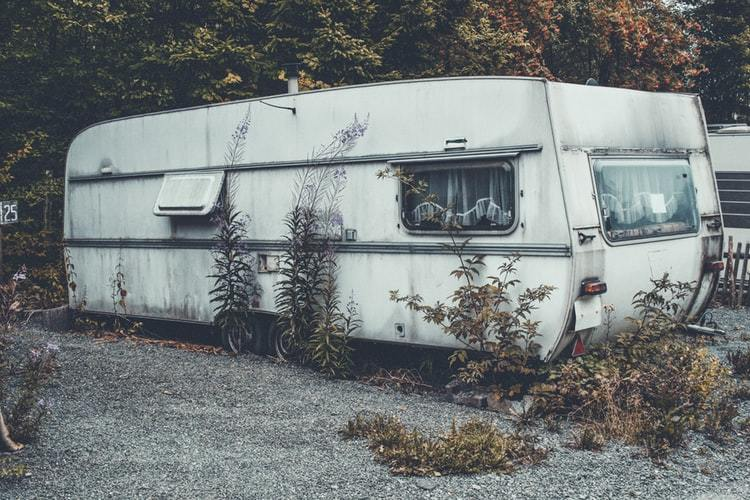 used rv parked in a forest