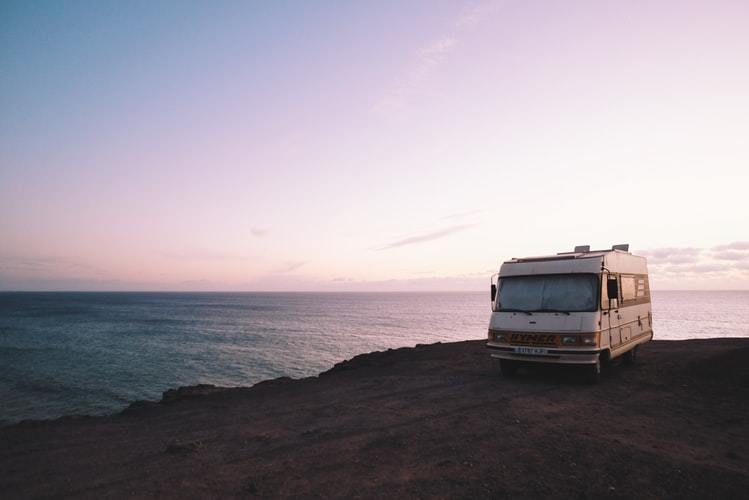used rv parking on a side of a cliff