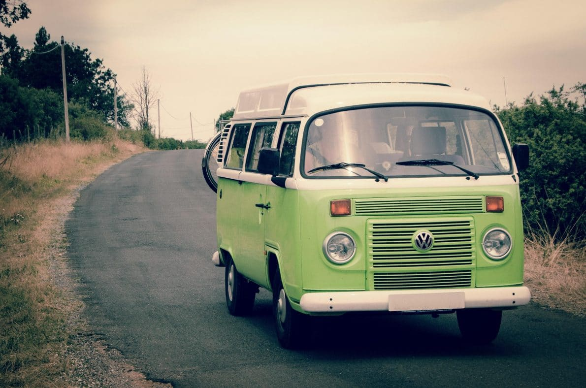 White and green Volkswagen RV on the road