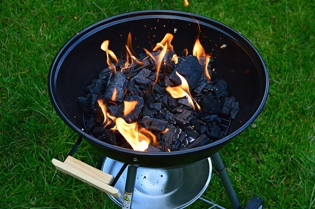 burning charcoal on grill