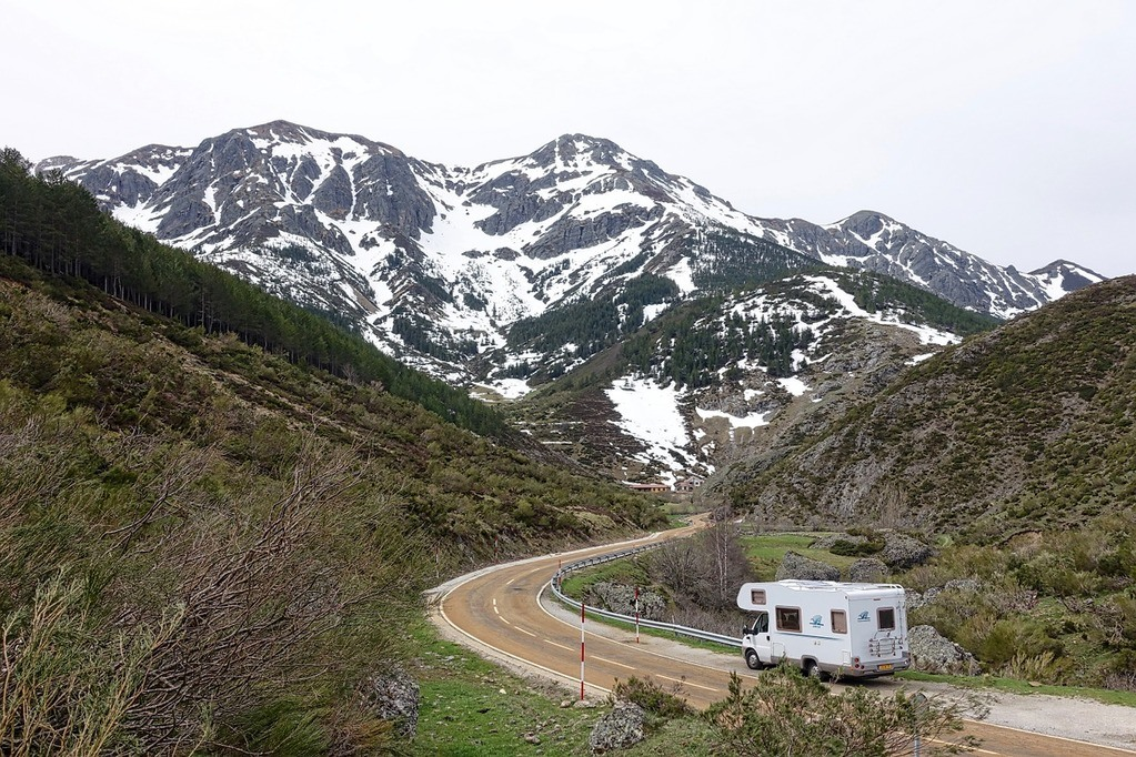 Best RV accessories: A motorhome driving doen a winding highway in the mountains