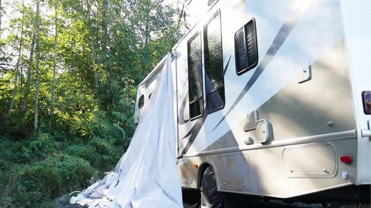 man fixing of his rv's cover