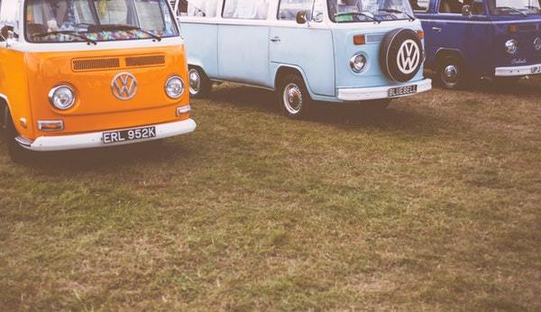three volkswagen RV parked